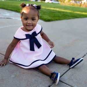 Cute toddler pink outfit with bows